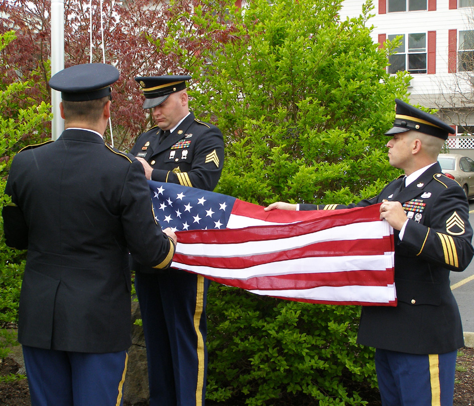 Military personnel preparing to raise the American flag near Somerset assisted living home in Longview, WA